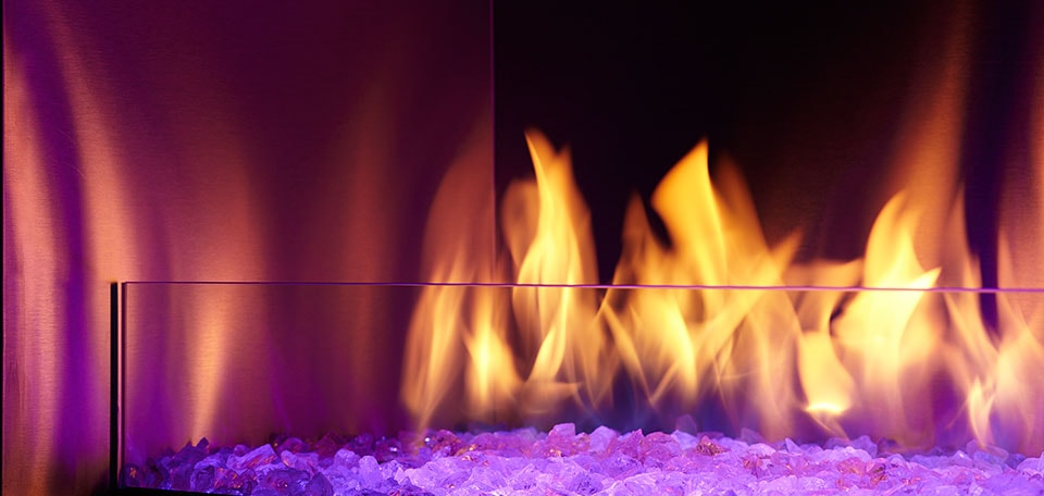 Palazzo Gas Fireplace close-up shown with purple LED lighting