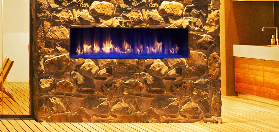 Palazzo Gas Fireplace shown with blue LED lighting