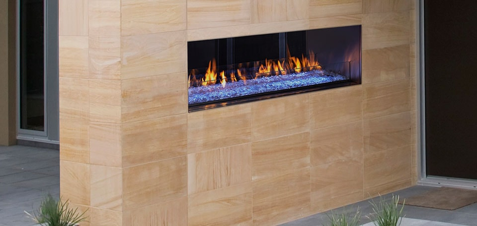 Palazzo See Through Gas Fireplace Shown With Blue LED Lighting