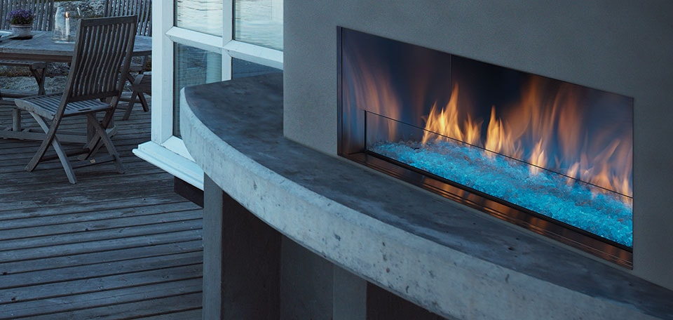 Palazzo Gas Fireplace shown with aqua LED lighting