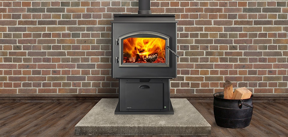 Adventure III Wood Stove shown with black arched door with satin nickel trim and optional satin nickel hinge pins